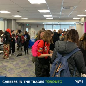 Exhibitors like HiMark and Building Up talk to local students in Toronto.