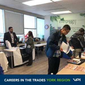 Job Seekers speak to exhibitors from Service Canada and Bliss Aesthetics about opportunities in the trades at Evergreen College in York Region.