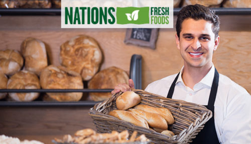 Man selling fresh pastry and baguettes in local tea-room