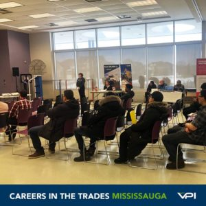 Students in Mississauga listen to a presentation about Sheridan College's  upcoming apprenticeship courses.